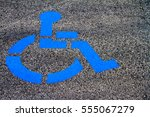 handicap parking emblem painted ... | Shutterstock . vector #555067279