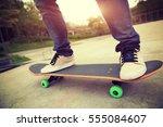 young skateboarder legs riding... | Shutterstock . vector #555084607