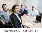 confident young manager raising ... | Shutterstock . vector #555084817