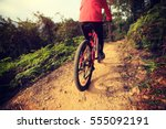 young woman riding bike on... | Shutterstock . vector #555092191