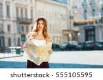 beautiful girl in hat holding... | Shutterstock . vector #555105595