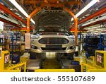 assembly shop at a car factory | Shutterstock . vector #555107689