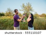 young happy couple on nature... | Shutterstock . vector #555110107
