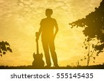 Silhouette Musician Holding A...