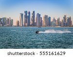Stock photo qatar skyline during golden hours with jet sky 555161629