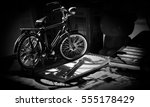 Small photo of Bicycle foreshorten on the table in dim light / Selective focus and adjustment black and white for background