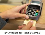 Small photo of finance, money, technology, payment and people concept - close up of hand inserting bank card to terminal