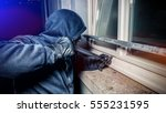 masked burglar with crowbar... | Shutterstock . vector #555231595