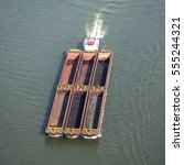 Small photo of 8 September 2016, Papendrecht, Netherlands. Aerial view of a barge pusher with an empty cargo hold at river Oude Maas on it's way to Rotterdam