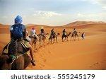 caravan going through the sand... | Shutterstock . vector #555245179