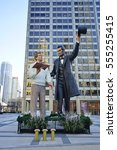 Small photo of CHICAGO, IL -6 JAN 2017- A large Seward Johnson statue of Abraham Lincoln holding the Gettysburg Address and giving it to a modern man was installed in 2016 in downtown Chicago.