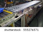 the production line conveyor... | Shutterstock . vector #555276571