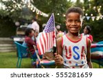young black boy holding flag at ... | Shutterstock . vector #555281659
