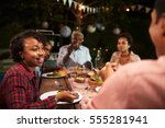 adult black family eat dinner... | Shutterstock . vector #555281941