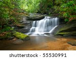 Motion Blur Waterfalls Peaceful Nature Landscape in Blue Ridge Mountains with lush green trees, rocks and flowing water - stock photo