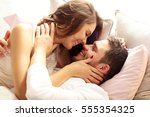 picture of young couple kissing ... | Shutterstock . vector #555354325