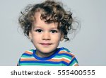 beautiful curly toddler looking ... | Shutterstock . vector #555400555
