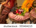 Small photo of The ceremonial adornment of wedding table traditional meats with onion flower