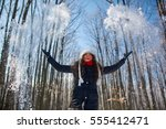 young woman throwing fresh snow ... | Shutterstock . vector #555412471