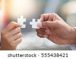 business people assembling... | Shutterstock . vector #555438421
