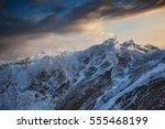 shorebreak wave crushing with... | Shutterstock . vector #555468199