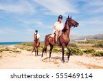 young tourist couple horseback... | Shutterstock . vector #555469114