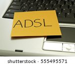Small photo of Memo note on notebook, asymmetric digital subscriber line, ADSL