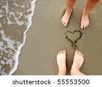 On the beach, two lovers - stock photo