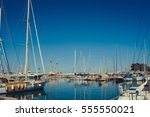 pier with yachts at sea on a... | Shutterstock . vector #555550021