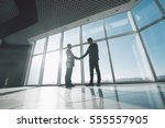 two young businessmen are... | Shutterstock . vector #555557905