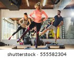 three athletes stretching and... | Shutterstock . vector #555582304