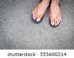 Feet Of A Man Wearing Sandals...