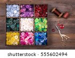 a box of colourful buttons ... | Shutterstock . vector #555602494