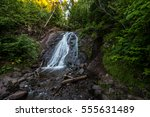 michigan roadside waterfall.... | Shutterstock . vector #555631489