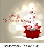 red hearts coming out from gift ... | Shutterstock .eps vector #555647134