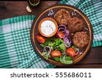 appetizing meat cutlet and... | Shutterstock . vector #555686011
