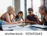 young people sitting together... | Shutterstock . vector #555692665