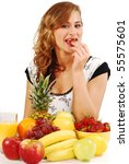 Young woman and fruits on the table - stock photo