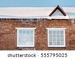 icicles on the rooftop or... | Shutterstock . vector #555795025