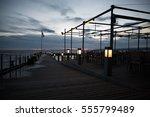 bar on pier and neusiedler see  ... | Shutterstock . vector #555799489