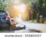 man playing guitar outdoors... | Shutterstock . vector #555805357