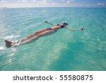 a young woman in a bikini... | Shutterstock . vector #55580875