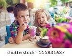 little boy with a girl eating... | Shutterstock . vector #555831637