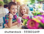 little boy with a girl eating... | Shutterstock . vector #555831649