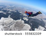 alone skydiver is in the free... | Shutterstock . vector #555832339