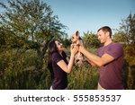 young happy couple in nature ... | Shutterstock . vector #555853537