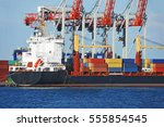 container stack and cargo ship... | Shutterstock . vector #555854545
