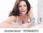 woman in bathroom | Shutterstock . vector #555868291