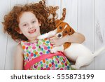 little girl is smiling and... | Shutterstock . vector #555873199