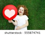 laughing girl in a white t... | Shutterstock . vector #555874741